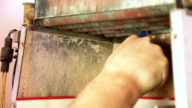 repairing heating gas boiler - boiler stock videos & royalty-free footage