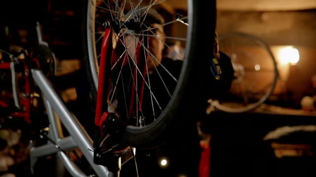 repairman repairing bicycle in workshop - wrench stock videos and b-roll footage