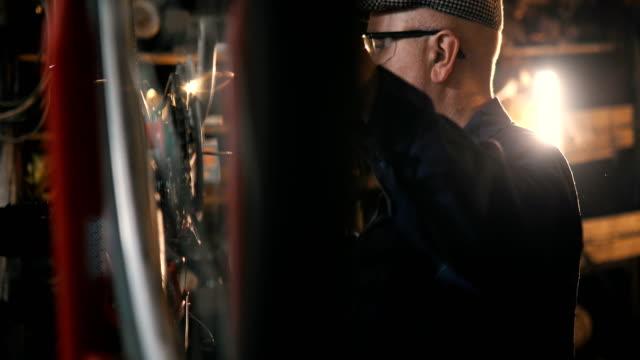 repairman repairing bicycle in workshop - repair shop stock videos & royalty-free footage