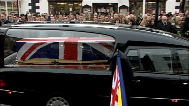 repatriation of bomb disposal expert killed in afghanistan england wiltshire wootton bassett ext mourners at roadside including heather wood hearse... - disposal stock videos and b-roll footage