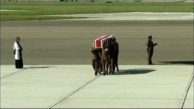 repatriation of british soldier killed in afghanistan england oxfordshire raf brize norton ext military pallbearers carrying flagdraped coffin of... - british military stock videos & royalty-free footage
