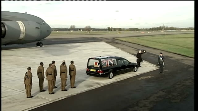 stockvideo's en b-roll-footage met repatriation of four soldiers killed in afghanistan; hearse carrying coffin drives away from runway as bugler heard playing last post sot - repatriëring