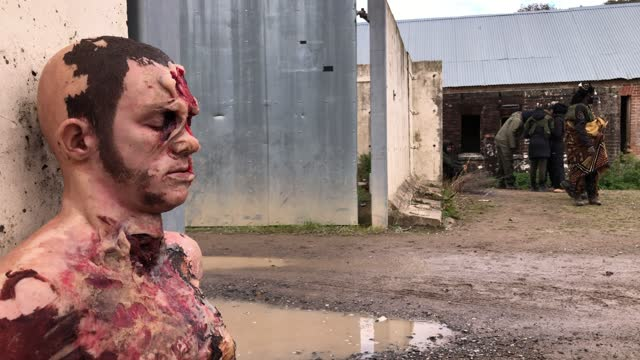 replica of a severely-injured man is seen on the floor as role-play actors prepare to take part in a scenario during a mission rehearsal exercise... - atlantic islands stock videos & royalty-free footage