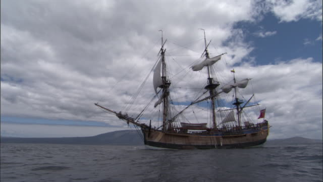 replica of hms endeavour sails on choppy water. - sailing ship stock videos & royalty-free footage