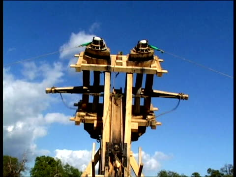 replica of roman catapult throws stone ball - weaponry stock videos & royalty-free footage
