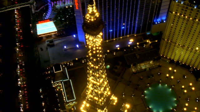 a replica of the eiffel tower illuminated at the paris hotel and casino in las vegas. available in hd. - replica eiffel tower stock videos & royalty-free footage