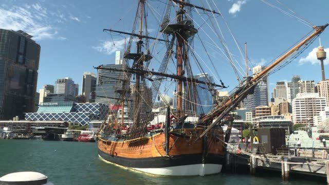 A replica of the Endeavour sits in Sydney's Darling Harbour as the centuries long hunt for the remains of famed ship the vessel used by James Cook on...