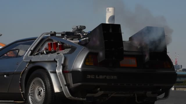 vídeos de stock, filmes e b-roll de a replica of the timetraveling delorean featured in the film back to the future owned by jeplan inc sits on display in tokyo japan on wednesday jan... - christopher lloyd ator