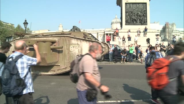 replica world war one tank placed in trafalgar square to mark anniversary england london trafalgar square ext people taking photographs as replica of... - armoured vehicle stock videos & royalty-free footage