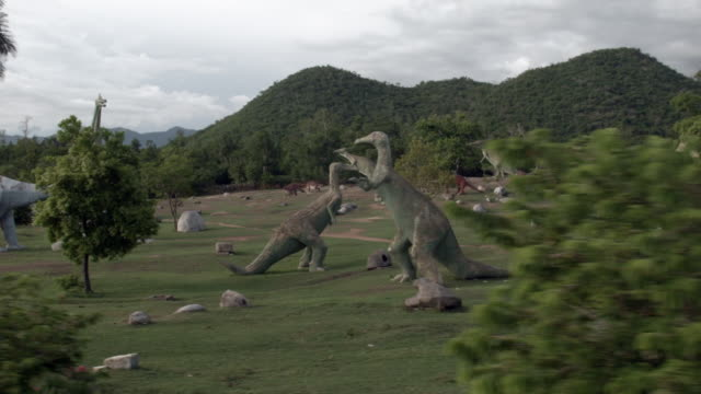 Replicas of dinosaurs at the Valle de la Prehistoria a prehistoricthemed attraction park opened in 1980 on September 23 2015 in Baconao Cuba Located...