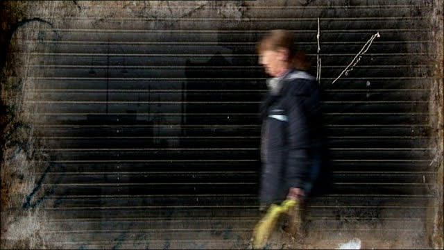 report claims 'billions needed' to meet child poverty targets abandoned shopping trolleys in street back view of two young people riding quad bike... - quadbike stock videos & royalty-free footage