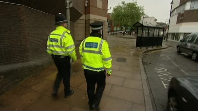 report finds essex police are failing domestic violence victims surrey guildford two police officers along on patrol sign 'police headquarters' gv... - サリー州点の映像素材/bロール