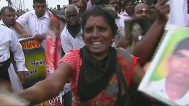 report finds evidence of human rights abuses by both sides in civil war; t15111324 / tx sri lanka: jaffna: ext demonstrators holding pictures of... - sri lanka stock videos & royalty-free footage