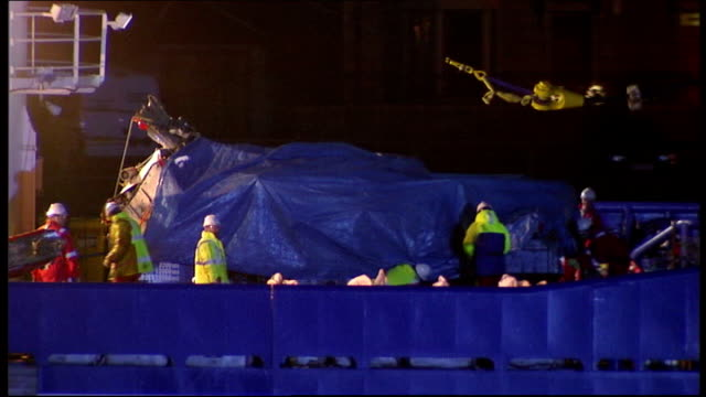 report finds north sea helicopter crash 'could have been avoided'; lib / t10040901 6.4.2009 scotland: aberdeen: ext / night wreckage of super puma... - aberdeen scotland stock videos & royalty-free footage