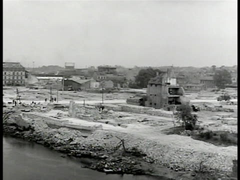 stockvideo's en b-roll-footage met report 'habitations' ws bombed city ruins ha ws houses under construction repair ms french workers carpenters tarring roof cu pouring spreading tar... - 1946