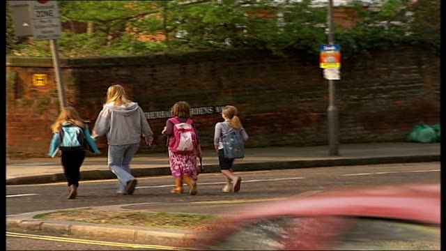 report highlights reluctance of parents to abandon school run hampstead fitzjohn's avenue carer and children walking on pavement mother pushing... - bicycle seat stock videos & royalty-free footage