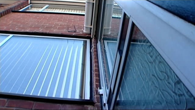 report into death of daniel pelka critical of agencies west midlands coventry ext low angle shot of front door of house where daniel pelka lived with... - 継父点の映像素材/bロール