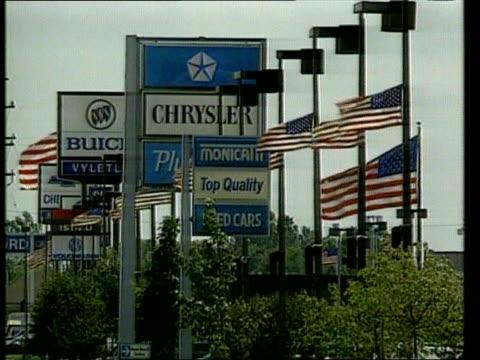 report oecd report itn lib detroit michigan gv car manufacturer signs ms car transporter alon pan rl and past - oeec video stock e b–roll