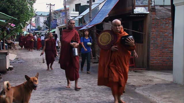 report on burmese economy taking off showing buddhist monks on rangoon street, street scenes, manufacturing clothing factory interiors and factory... - film container stock videos & royalty-free footage