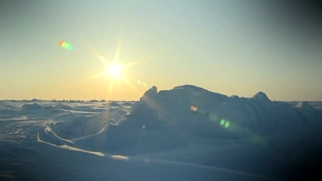 global warming affecting the whole planet t10041331 sun shining over ice sheets - 全部点の映像素材/bロール