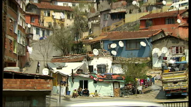 ipcc report on climate change to be published turkey istanbul ext makeshift housing settlement person along carrying balloons people along in town... - makeshift stock videos & royalty-free footage