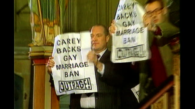 report on cultural attitudes in britain; lib - orig tx 12.4.98 canterbury cathedral: int peter tatchell and other campaigners holding up outrage... - canterbury cathedral stock videos & royalty-free footage
