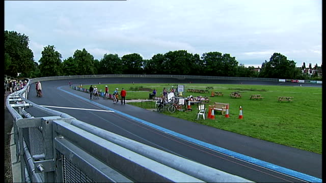 report on herne hill velodrome and how it influenced success of bradley wiggins england london herne hill velodrome group of cyclists cycling towards... - herne hill stock videos & royalty-free footage