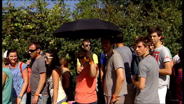 report on hot temperatures in london wimbledon all england lawn tennis club long queue of tennis fans queuing for tickets woman in queue using... - straw hat stock videos and b-roll footage