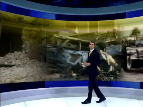 report on latest attacks on iraqis; itv evening news: bill neely england: london: gir: int i/c at video wall - itv evening news stock-videos und b-roll-filmmaterial