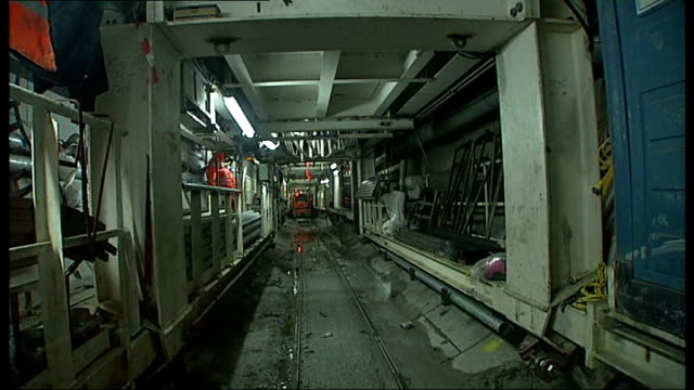 report on progress of crossrail project; england: london: int train driver's point of view along through crossrail tunnel / reporter wearing helmet... - tape measure点の映像素材/bロール