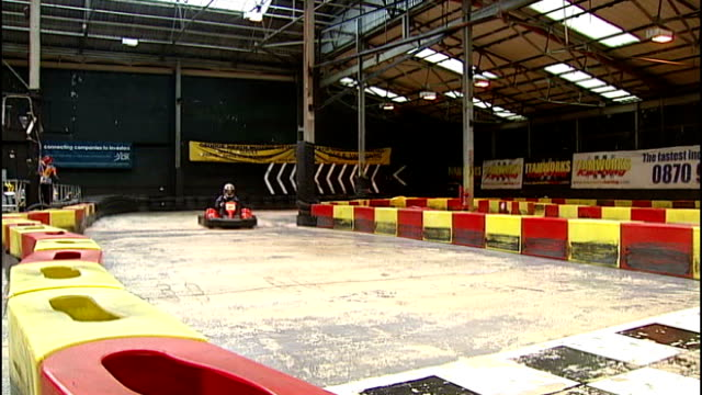report on recession victims in bristol and birmingham; england: west midlands: birmingham: teamworks karting: ext point of view shot from go-kart... - go cart stock videos & royalty-free footage