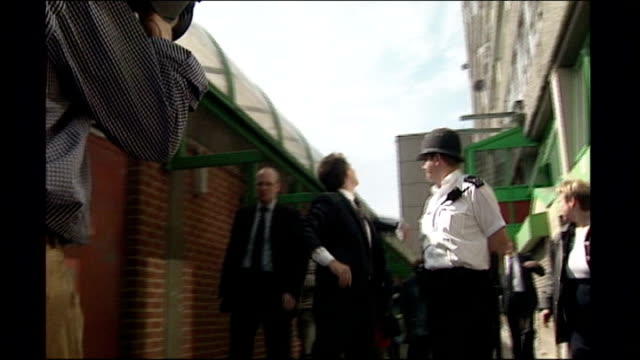 report on social housing tx tony blair mp on visit to aylesbury estate dissolve to - grounds stock videos & royalty-free footage