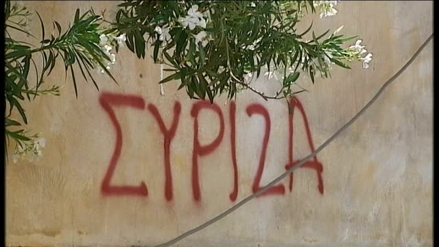 report on the town of lavrio which has turned to left wing party seereeza wall with 'syriza' written in greek letters 'syriza' graffitti 'syriza'... - jug stock videos & royalty-free footage