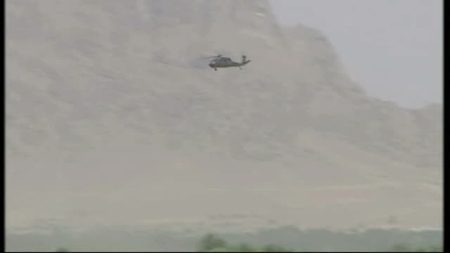 Kandahar Argandab Valley Kuhak EXT Black hawk helicopter flying past mountains