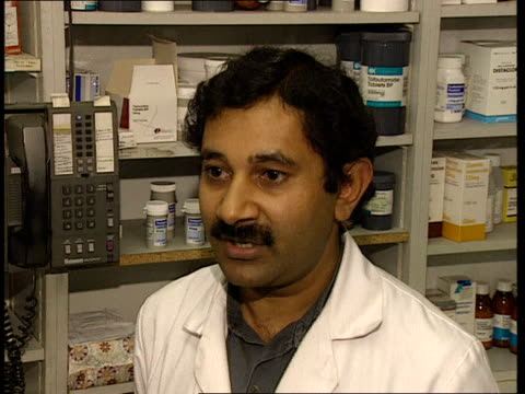 london ms pharmacist lalit shah as counting out tablets for prescription pull out cms shah cs tablets into jar cms lalit shah intvwd sot doctors... - pharmacist stock videos & royalty-free footage