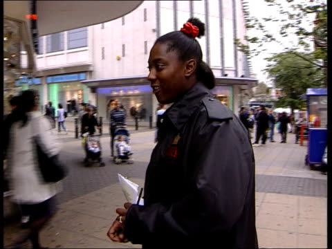vídeos y material grabado en eventos de stock de report reveals racism sexism itn england birmingham ext la ms legs towards on street ms black fire officer samantha gordon asking black teenage girl... - recluta