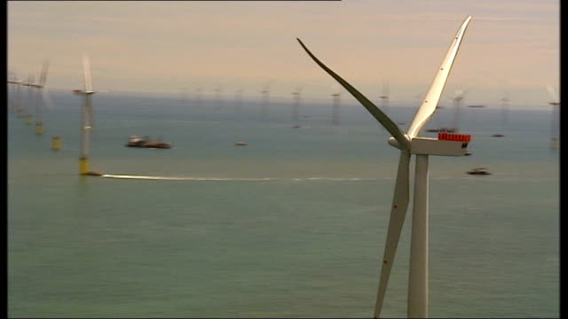 vidéos et rushes de report says offshore wind farms too expensive at sea north sea pilot flying helicopter zoom to show the sea through front window ext air views /... - à bord