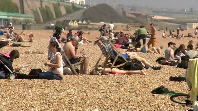 report shows some sun creams not offering advertised level of sun protection; england: east sussex: brighton: ext / sunny high angle shot showing... - deck chair stock videos & royalty-free footage