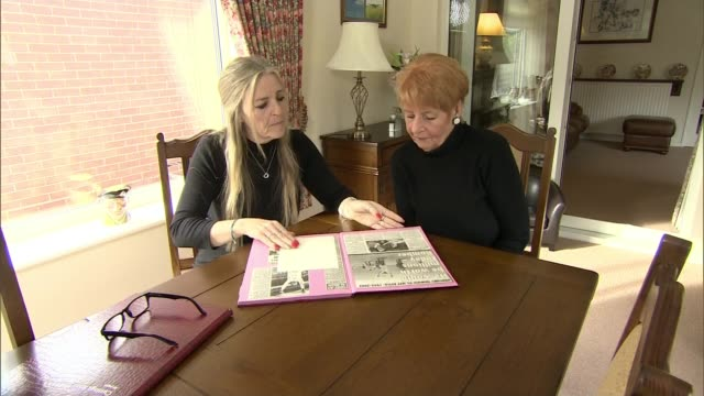 report states exfootballers more likely to die from dementia england int various shots of laraine astle and dawn astle looking at scrapbook - jeff astle stock videos & royalty-free footage