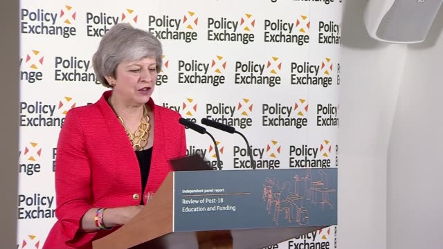 Report suggests cutting university tuition fees and reintroducing maintenance allowance ENGLAND London Theresa May to podium at 'Review of Post18...