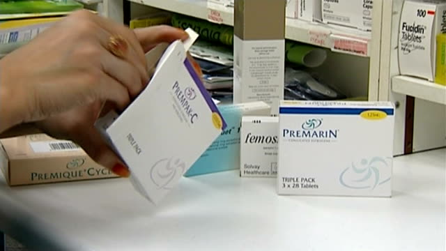report suggests hrt use increases risk of ovarian cancer r19040705 packets of prempakc and premarin tablets as box opened and blister packs of... - hormone stock videos & royalty-free footage