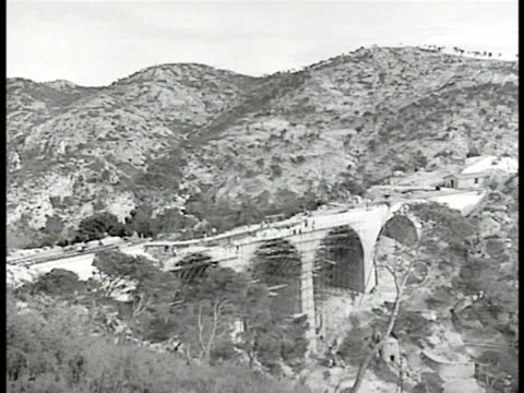 stockvideo's en b-roll-footage met report 'transports ferroviaires' vs rail road bridge viaduct under construction french workers la ws incomplete bridge vs scaffolding workers ha ws... - 1946