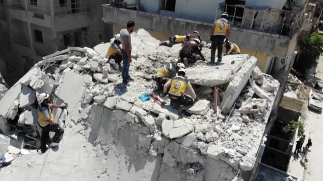 vídeos de stock, filmes e b-roll de reported air raid on the town of ariha in the south of syria's idlib province killed 11 civilians among them two children said the syrian observatory... - air raid