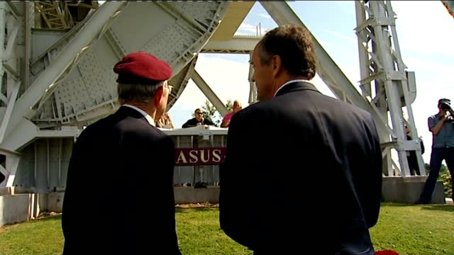 reporter along with raymond rayner and looking at bridge raymond rayner interview sot members of the parachute regiment reenacting a dday parachute... - enacting stock videos & royalty-free footage