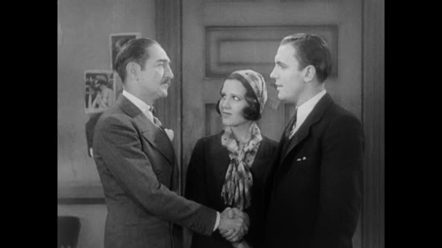 1931 reporter (pat o'brien) and editor (adolph menjou) compliment each other as they say goodbye - 1931 stock videos & royalty-free footage