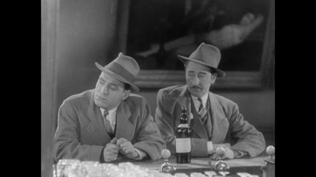 1931 reporter (pat o'brien) and his editor (adolph menjou) have sad, somber discussion on the 'benefits' of marriage - 1931 stock videos & royalty-free footage