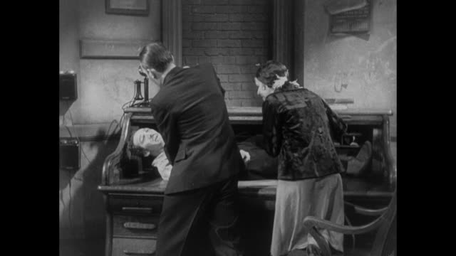 1931 reporter and woman hide escaped convict in roll top desk - 1931 stock videos & royalty-free footage