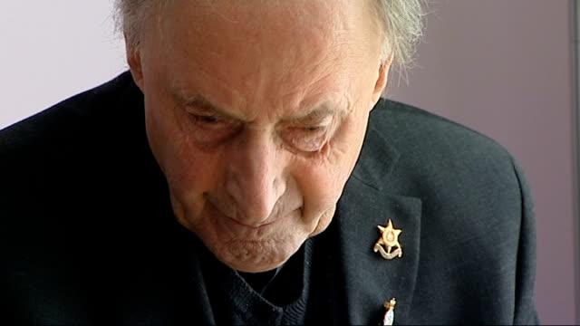 reporter chatting to reverend day close up of 'burma star association' pin worn by reverend day audrey day interview sot reverend day speaking... - hernia stock videos and b-roll footage