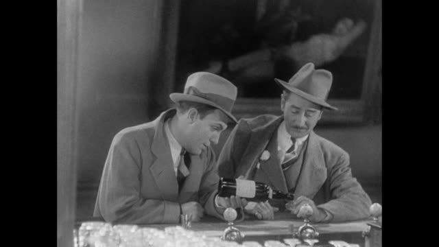 1931 reporter (pat o'brien) drinks and reminisces with his editor (adolph menjou) - 1931 stock videos & royalty-free footage