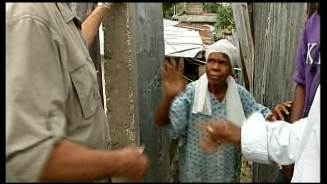 reporter enquiring about woman with injured eye sot close shot of woman marizeta with injured eye various shots of reporter with old woman elderly... - hispaniola stock videos & royalty-free footage